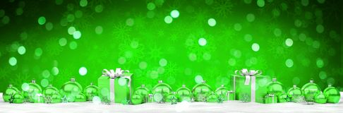 Green and white christmas gifts and baubles lined up 3D renderin. Green and white christmas gifts and baubles lined up on snowy background 3D rendering Royalty Free Illustration