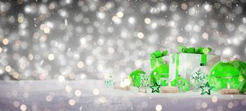 Green and white christmas gifts and baubles on snow 3D rendering. Green and white christmas gifts and baubles on snowy background 3D rendering Vector Illustration