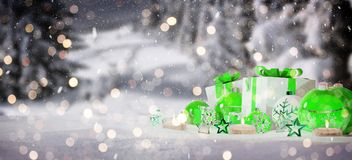 Green and white christmas gifts and baubles on snow 3D rendering. Green and white christmas gifts and baubles on snowy background 3D rendering Stock Illustration