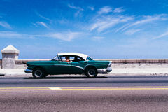 Green and White Convertible Coupe on Day Time Stock Image