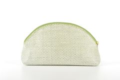 Green and white cosmetic bag on white background. Royalty Free Stock Image