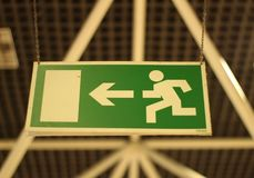 Green and white emergency exit sign royalty free stock photos