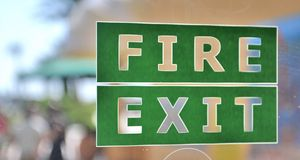 Green and white fire exit sign Stock Photography