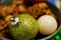 Green and white glittery Christmas holiday decorative ornaments Royalty Free Stock Photos