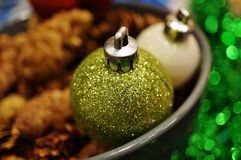 Green and white glittery Christmas holiday decorative ornaments Stock Photo