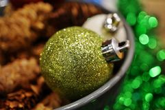 Green and white glittery Christmas holiday decorative ornaments Stock Image