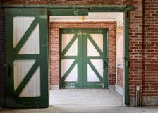 Green and white horse stable doors Royalty Free Stock Images
