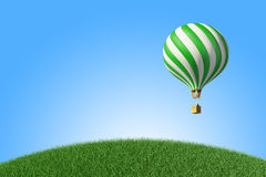 Green-white Hot Air Balloon in the blue sky Royalty Free Stock Images