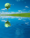 Green-white Hot Air Balloon in the blue sky. 3D Render Royalty Free Stock Photo