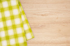 Green and white kitchen textile texture on wood background Royalty Free Stock Photography