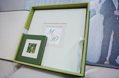 Green and white leather wedding photo book Stock Photos