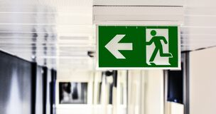 Green and White Male Gender Rest Room Signage Stock Image