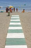 Green and white path leading to beach in Spain Stock Photo