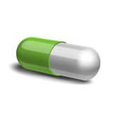 Green and white pill Stock Images
