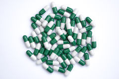 Green and white pills Stock Photo