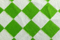Green white plaid blanket. Green and white plaid blanket as background Stock Image