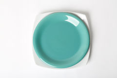 Green and white plate. On white background Stock Photos