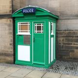 Green and white police box Stock Images