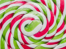 Green, white and red candy Christmas stick, lollipop Stock Photo
