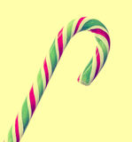 Green, white and red candy Christmas stick, lollipop, spiral shape round, isolated. Royalty Free Stock Photography