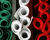 Green White red coloured felt rolls on sale in the italian shop Stock Photos