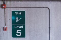 Green and White Stair Level 5 Signage Royalty Free Stock Photo