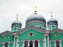 Green white stone Cathedral with domes close-up royalty free stock images