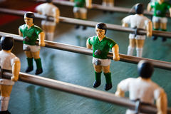 Green and White Table Football with steel shafts Stock Image