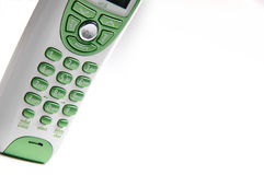 Green and white telephone. Green and white handhled telephone stock images
