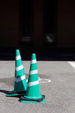 Green and white traffic cone on the road. The green and white traffic cone on the road royalty free stock photos