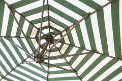 Green and white umbrella Stock Image