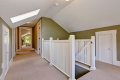 Green and white upstairs hallway with vaulted ceiling and skylig Stock Images