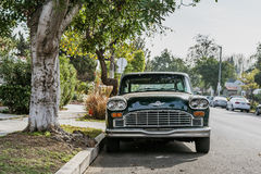 Green and White Vintage Car Beside Green Leaved Tree Stock Image