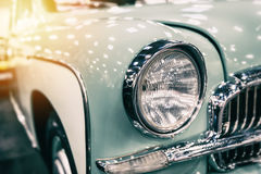 Green and white vintage car. In the sunlight Royalty Free Stock Image