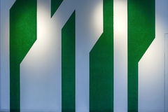 Green and white wall with spotlight Royalty Free Stock Image