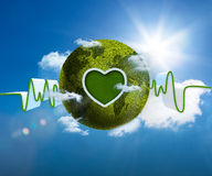 Green and white waveform with green earth and heart shape. On blue sky background Stock Images