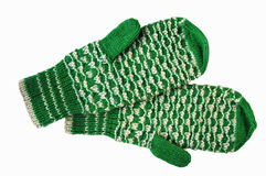 Green and white woolen mittens. An isolated view of pretty, hand knit green and white woolen mittens royalty free stock photos