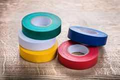 Green white yellow red blue rolls of insulating Stock Photos