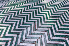 Green and white zigzag Old brick block used for out door walk wa. Y this array diagonal in traditional pattern, texture for background Royalty Free Stock Image