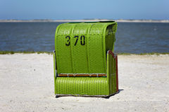 Green wicker beach chair Royalty Free Stock Images
