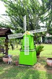 Green wind turbine in the garden Stock Photo