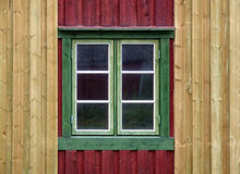 Green window. Colorful wall and a single window with a green frame Royalty Free Stock Image