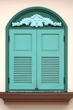 Green window of building on cream background, Classic style. Royalty Free Stock Image