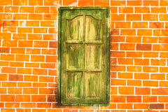 Green Window on Distorted Wall Stock Images