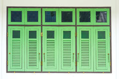 Green window. Old ancient window in Thai temple stock photos
