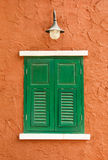Green window on orange wall Royalty Free Stock Photos