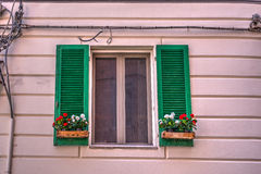 Green window in a pink wall Stock Photos