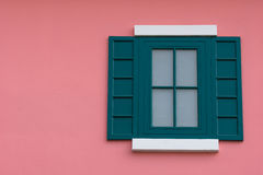Green window on the pink wall. The green one with pink walls Royalty Free Stock Photo
