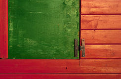 Green window on red planks. Background with green window on red wooden planks Stock Image
