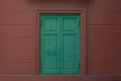 Green window. With Red Wall Stock Image